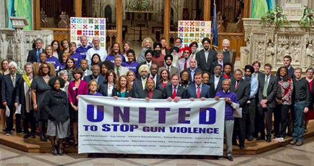 Photo of people at Cathedral with a sign that says United to Stop Gun Violence